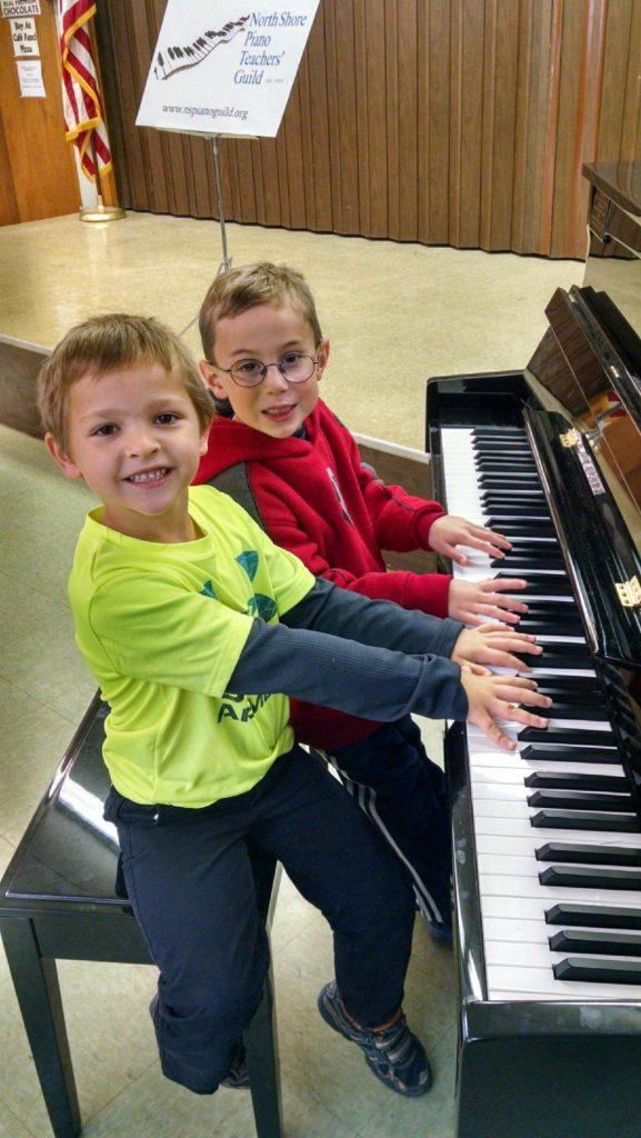 2-little-boys-playing-duet